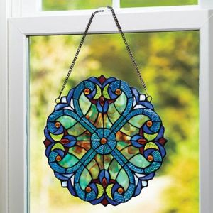 You got to love the stained glass on this. Seems like it comes straight from a Tiffany lamp. Very beautiful.