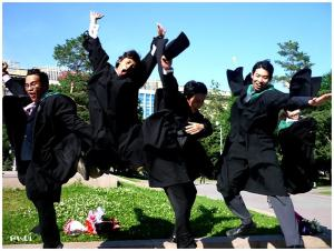 I think these guys are from China. Still, all seem to have their gown blowing with one jumping into the air.
