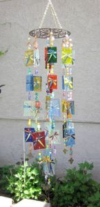 Dragonflies aren't the kind I'd have in mind for wind chimes. But these look great on the squares. Lovely.