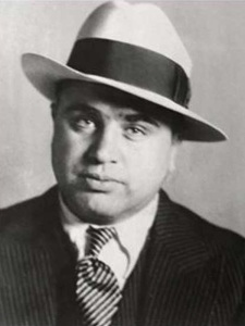In his public persona, Al Capone would seem to you like a big, friendly guy you'd want to have a beer with. However, keep in mind that this guy dominated Chicago as head of an organized crime syndicate during Prohibition. And it's very likely that he was involved in the Saint Valentine's Day Massacre. But at least you can be grateful that he was brought down by the IRS.