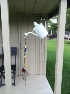 This one has beads coming out from a watering can. Not sure why the wire ends are there. Probably for decoration.