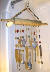 This one consists of a rolling pin and utensil chains. A bit large for any window, don't you think?
