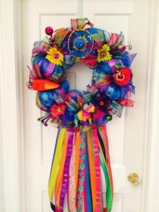 Yes, it's another Cinco de Mayo wreath. I have quite a few of them on this post. But this one has thicker ribbons and a sombrero on top.