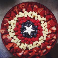 This includes strawberries, cheese, raspberries, and blueberries. Mostly fruit but the colors are consistent with the shield.