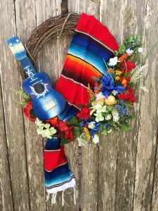 This one seems more simpler than the other wreaths. Maybe because it uses a serape, a guitar, and some floral decor.