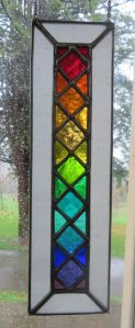 Kind of reminds you of as stained glass rainbow window. Like the squares.