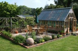 Love the woodwork on this. Love how it matches the greenhouse and the furniture.