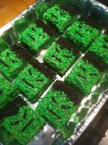 Hulk snacks on these Rice Krispie treats. Treats green with sprinkles, too.