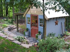 Well, this shed looks as colorful as it is rustic. Love the roof and the stonework outside.