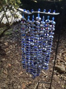 These beads seem to resemble stones. Wonder if this wind chime is meant to represent a waterfall.