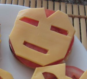 The cheese has Iron Man's face on it. The tomato is for background. Bound to do Stark Industries proud.