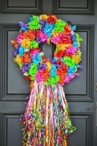 Well, that certainly looks festive. Love the bright colors and ribbons on this one.