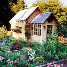 Well, I think this shed makes the garden seem more sunny. Love the window frames.