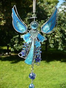 This one uses wire, marbles, and glass for this angel. And the results are wondrous beyond compare.