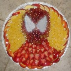 Yes, this fruit salad in the form of Spider Man. And it's filled with apple slices, pineapple, strawberries, and grapes.