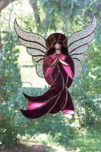 Yes, I know I've been putting a few angel suncatchers up. But trust me, this one is incredibly beautiful.
