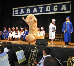 I'm sure the parents with small children had a very tough time explaining this moment. Seriously, who the hell crashes a graduation in a dick costume? Then again, there's that one college in Rhode Island that has a mascot named Scrotie.