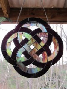 This one has rainbow glass surrounded by black. Very pretty though. So lovely.
