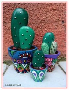 Yes, I know these are rocks painted as cacti. But at least these are in appropriate Mexican inspired painted flower pots.
