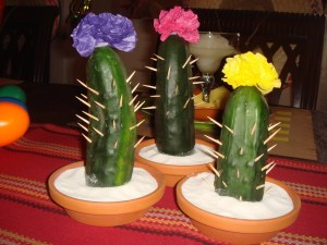 I've seen a lot of these, too. A lot of them are just cucumbers in pots with toothpicks in them. At least these have flowers.