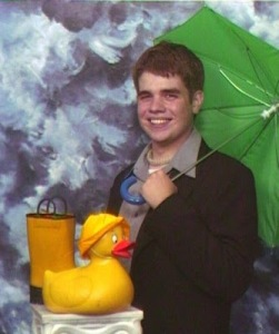 Wouldn't be surprised if Ernie from Sesame Street had a senior picture like this. However, this isn't Ernie.