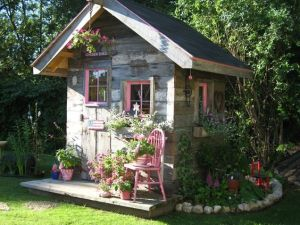 This is rustic enough for a garden. And it has some pink in the windows to stand out and blend with the flowers.