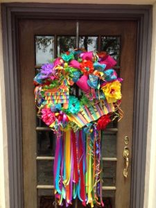 "Yes, this is a very festive wreath indeed. Not because it's in bright colors with ""Fiesta"" on it."