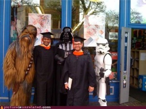 I'm sure these grads will treasure this moment forever. Guess there was a Star Wars convention in their town at the time.