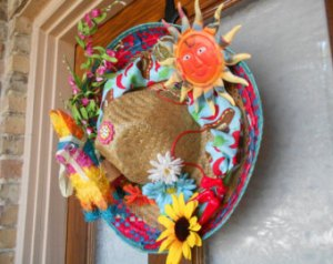 This one has a pinata, a sun, and a sunflower as well as a few other things. In any case, makes a lovely door decoration.