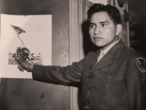 While Ira Hayes became a national hero for being among the 6 flag raisers at Iwo Jima, he was never comfortable with fame and descended into alcoholism after his Marine services. Flags of Our Fathers suggests that he might've suffered from PTSD.