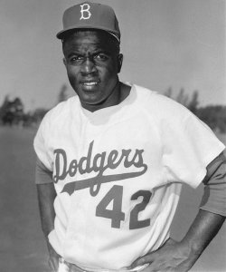 As the first African American man to play a major league sport in the modern era, Jackie Robinson challenged the traditional basis of racial segregation through his exceptional talent, his use of nonviolence, and his dignified character. His 10 year career with the Brooklyn Dodgers and off the field activities greatly contributed to the Civil Rights Movement.