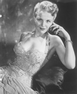 From vocalist to her local radio station to singing with Benny Goodman's big band, Peggy Lee would become a noted multi-faceted artist and performer writing music for films, acting, and creating conceptual record albums. On Lady and the Tramp, she not only sang, but also wrote some songs as well as provided the voices of 4 characters. Why she was omitted from the Oscars in memoriam roll in 2002, I have no idea.