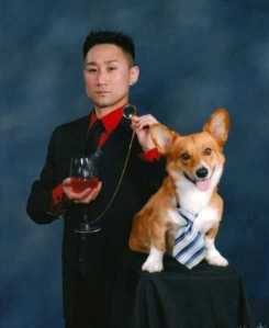 Let's hope there's no alcohol in that wine glass. Also, why is his dog wearing a tie?