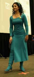 Well, that blue dress is lovely. However, as far as the TNG cast is concerned, she's not among the most liked.