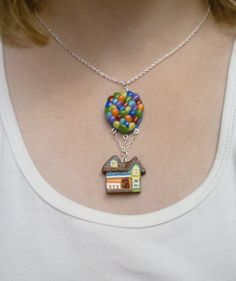This one is a pendant of the house from Up with balloons. Yes, it's fine craftsmanship but very delicate.