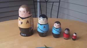 Includes Kirk, Spock, McCoy, Uhura, and Scotty. Not sure about the painting style though.