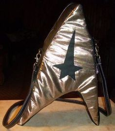 Yes, this is a Starfleet purse since it has the logo. Not sure how much it could fit. But I do like the shiny gold color.
