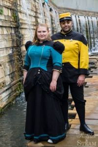 Once again, I give you more Star Trek Steampunk. The guy resembles a train conductor. Like the woman's dress, too.