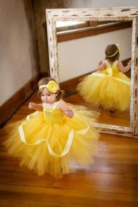 Yes, she's so adorable in that little yellow tutu dress. So sweet.