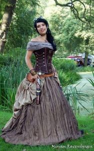 Out of all the women's costumes on this post, this one actually comes close to what a Victorian lady would actually dress like. Well, from the 1870s to 1880s anyway since it contains a bustle.