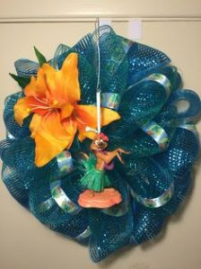 Yes, this blue deco mesh wreath features Timon when he and Pumbaa put on a song and dance routine to distract the hyenas. It's in the movie, by the way.
