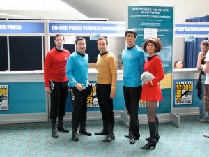 I guess these consist of Kirk, Spock, McCoy, Uhura, and Scotty. And it seems Uhura is holding a tribble.