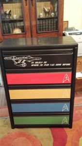 Has drawers of 5 different colors. Probably made by some Trekkie with too much time on their hands. But that's just my theory.