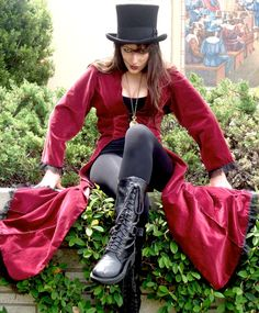 Well, a red cloak and top hat sure look smashing on anyone. And I'm sure it looks pretty on her, too.