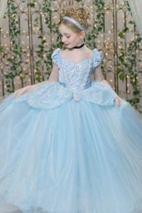 And she seems so happy in her ball gown, too. Hope she doesn't leave any glass slippers behind.
