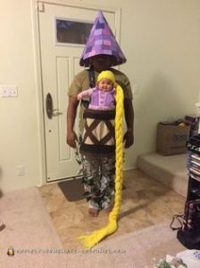 Like how the baby's dressed as Rapunzel and the dad's dressed as the tower. Now that's being a great parent. So cute.