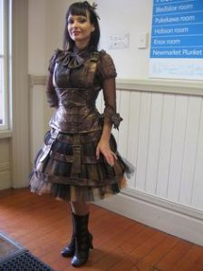 Then again, a lot of steampunk fashion has rusty brown. But she also wears a lot of leather, too.