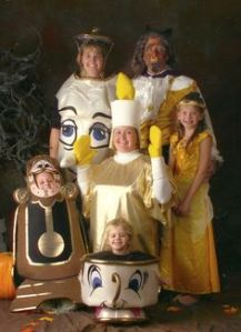 Yes, this is a family dressed as characters from Beauty and the Beast. Well, at least the ones at the castle.