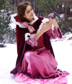 Belle also goes through a few wardrobe changes in Beauty and the Beast. And here she is with a bird.