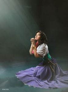 Here she's praying to God for the outcasts. Yet, in the movie, she's also one herself. And it's too bad Frollo is lusting after her which is creepy.